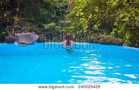 Loose Hair Woman In Blue Swimming Pool. Girl In Open Swimming Pool. Summer Vacation Vintage Toned Ph