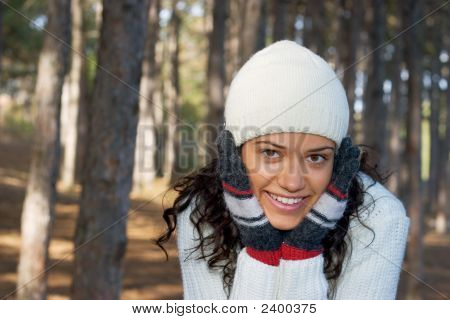 Beautiful Girl In White With Winter Hat