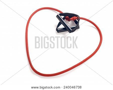 Red Fitness Expander In The Form Of Heart On White Background