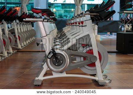 Rimini, Italy - June 2017: Fitness Workout In Gym: Group Of Modern Spinning Bikes In Line.