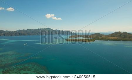 Aerial View: Beach, Tropical Island, Sea Bay And Lagoon, Mountains With Rainforest, Busuanga, Palawa