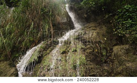 Waterfall In Green Forest In Jungle. Beautiful Waterfall In The Mountains. Tropical Rain Forest With