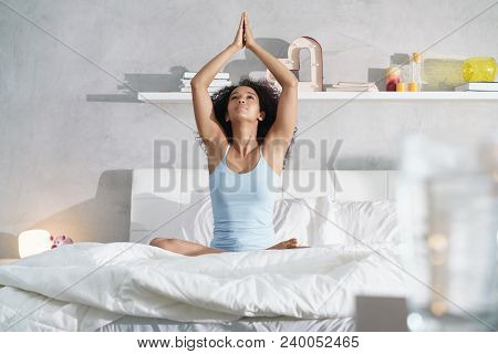 Pretty Black Girl With Curly Hair Sitting In Bed In The Morning. Beautiful Young African American Wo