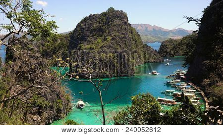 Tropical Lagoon With Azure Water, Beach By The Kayangan Lake, Philippines. View Coron Island, With C