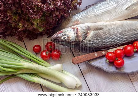 Fish European Bass (dicentrarchus Labrax), Italian Salad, Green Onions And Cherry Tomatoes On A Wood