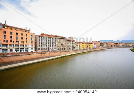 Old residential architecture with river Arno in Pisa, Italy. poster