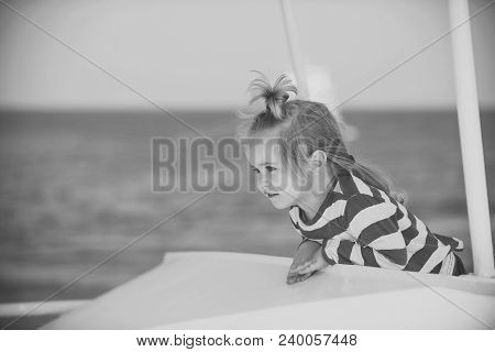 Childhood And Happiness Concept. Boy Little Kid With Cute Serious Face Sailing On White Ship. Summer