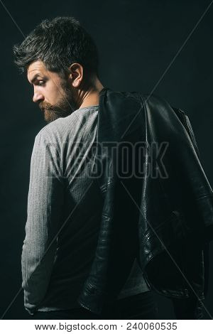 View From Behind Bearded Man Carrying Black Leather Jacket On Shoulder. Casual Attractive Handsome M