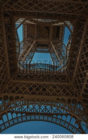 Paris, France - July 07, 2017. Bottom View Of Eiffel Tower Made In Iron And Art Nouveau Style, With