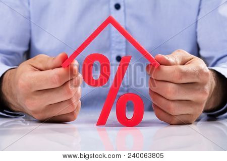 Businessperson Holding Roof Over Protection Sign