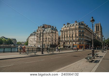 Paris, France - July 08, 2017. People On Bridge Over The Seine River With Sunny Blue Sky In Paris. K