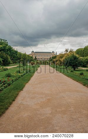 Paris, Northern France - July 10, 2017. Path With Building In The Background And Grassy Wooded Yard