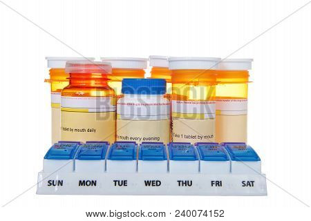 Twice Daily Medication Organizer With Many Bottles Of Pills Stacked Behind It Isolated On White Back