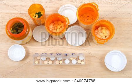 Prefilling Once A Day Medication Box With Many Pills. The Importance Of Medication Management Cannot