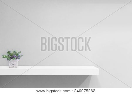 Empty White Shop Shelf, Retail Shelf On Blue Vintage Background.