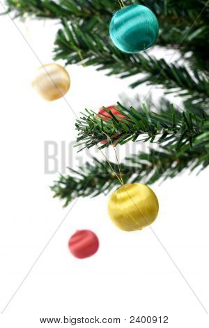Christmas Balls Hanging On Fir Tree Isolated