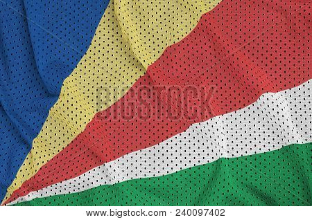 Seychelles flag printed on a polyester nylon sportswear mesh fabric with some folds poster