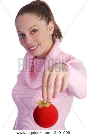Young Womanl Holding Red Christmas Ball