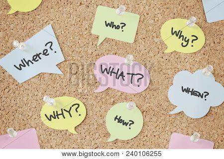 Questions Speech Bubbles On Cork Bulletin Board
