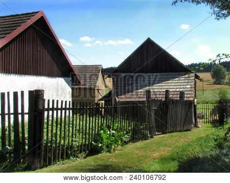 Typical Rural Landscape With Barn And Farmhouse, Wood Fence In Czech Republic