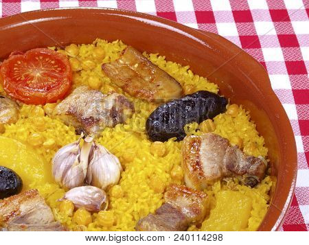 Arroz Al Horno - Oven Cooked Rice Traditional Valencian Dish. The Paella Is The Most Worldwide Well-