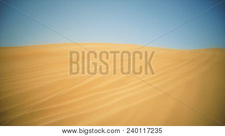 Sand Desert And Blue Sky. Stock. Desert On A Sunny Day.