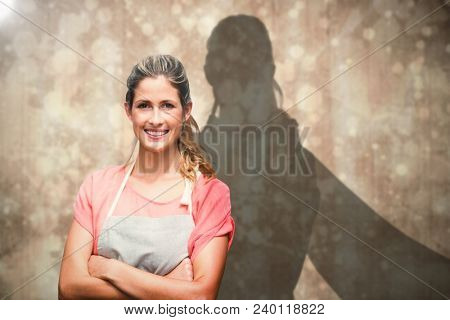 Composite image of portrait of smiling young woman with arms crossed