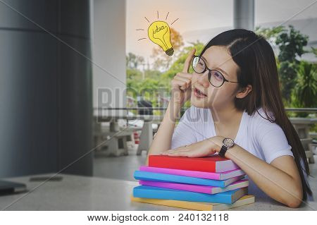 Thinking Idea Student Girl With Glasses And Books On Desk, Bored And Tired To Reading Books For Exam