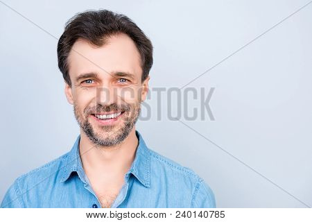 Close up front view portrait of mature cheerful excited satisfied glad virile masculine man wearing jeans denim shirt isolated on gray background empty blank place copyspace poster