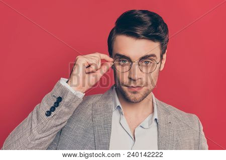 Close Up Portrait Of Clever, Smart, Shaved Manly, Stunning Guy In Glasses Holding Eyelet Of Spectacl