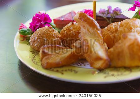 Croissants And Bread Served On Plate For Breakfast.