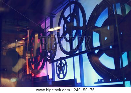 Abstract Gear Wheel On The Wall Background.