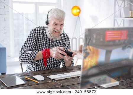Great Gaming Experience. Upbeat Elderly Man Being Excited While Playing A Multiplayer Online Video G