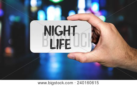 Hand Holding Placard With Word Night Life. Photo Stock.