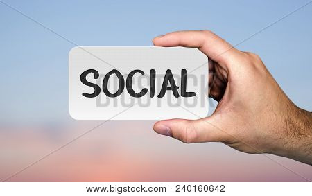 Hand Holding Placard With Word Social. Communication Concept. Photo Stock.