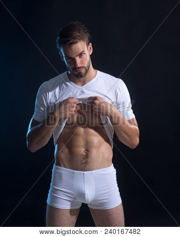 Bearded Man, Young Athletic Sexy Guy With Muscular Body And Torso In Underwear Undressing On Dark Ba