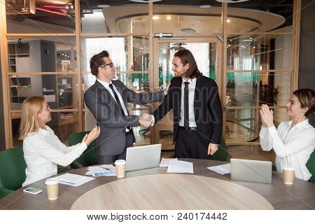Company Executive Or Boss Promoting Handshaking Successful Manager While Team Supporting Applauding