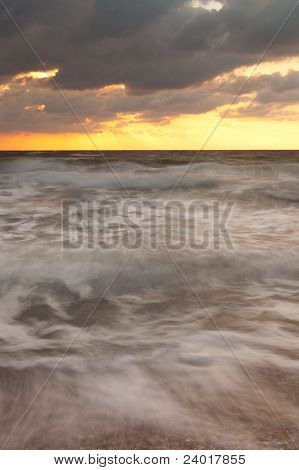 Sunset On The Sea With Stormy Clouds