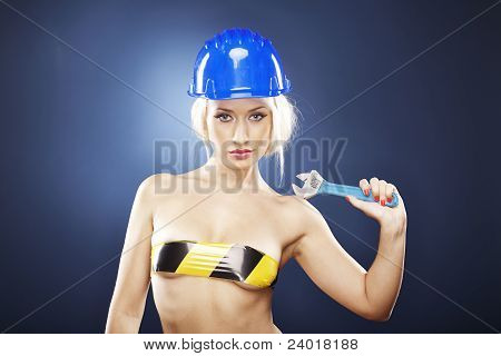 Blonde Model With Construction Helmet And Adjustable Wrench