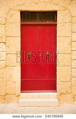 Red Colored Wooden Door, Sand Stone Wall In Medina City, Malta