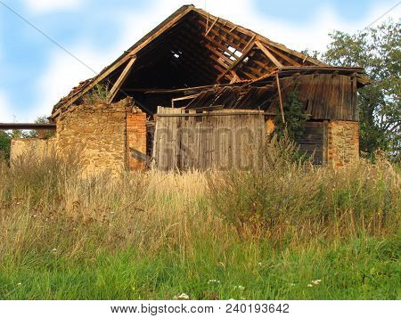 Abadoned Barn Ruin On The Edge Of The Village, Old Dilapidated Farmhouse