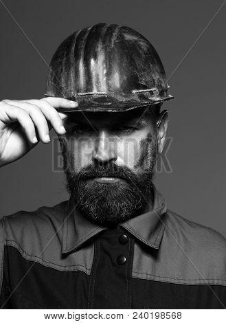 Industrial Worker. Hard Work. Builder Working With Construction Helmet. Builder In Protective Clothi