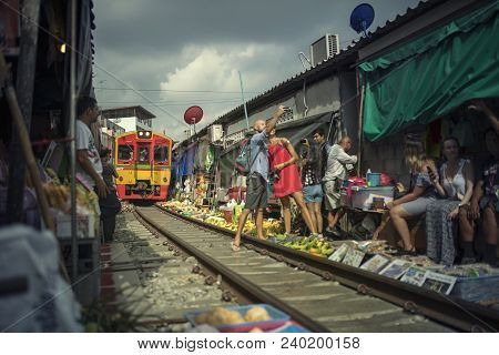 Meklong Thailand - May11,2018 : Unidentified Tourist Taking Selfies Photograph While Domestic Trains