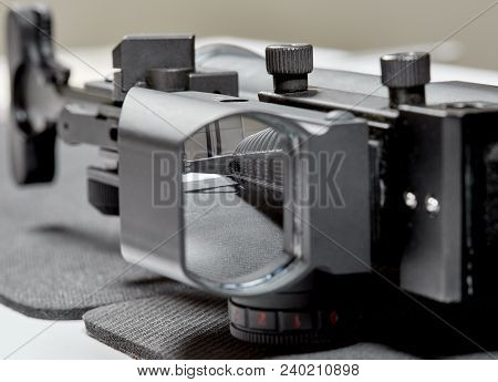 Ar15 Rifle Laying On A Table Looking Through The Scope