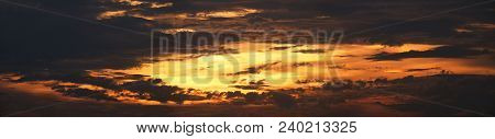 Silhouette Of Clouds During Sunset In Panorama Aspect Ratio