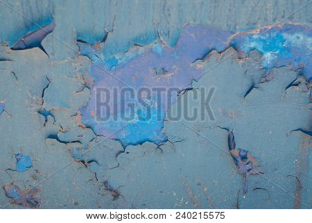Old Cracked Blue Paint Peeled Wall. Peeling Paint. Pattern Of Blue Grunge Material. Damaged Paint. W