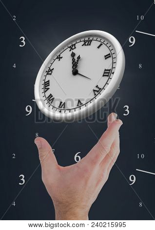 Hand holding a clock against background with clocks