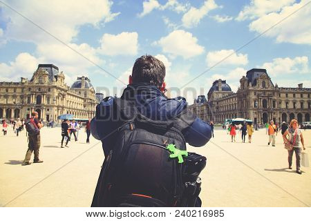 Paris, France - June 14, 2013: Photographer Makes Shots At The Carusel Square In Paris. View From Th