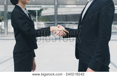 Businessman Shaking Hands With Business Woman For Demonstrating Their Agreement To Sign Agreement Or