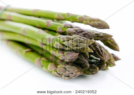 Bundle Of Fresh And Green Asparagus Isolated On White Background In Close-up